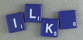 SCRABBLE tile style S51W : Purple tile with white letter